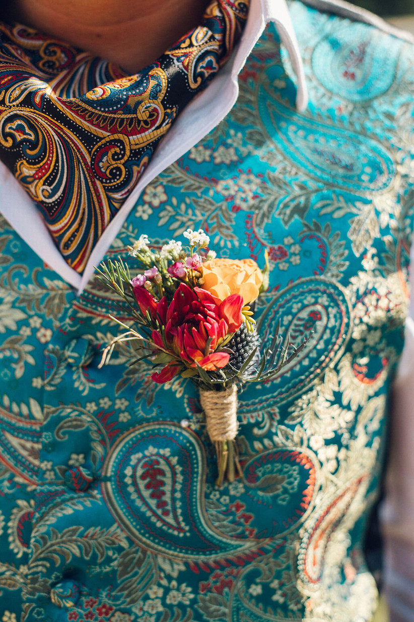 Groom wearing a bright wedding buttonhole