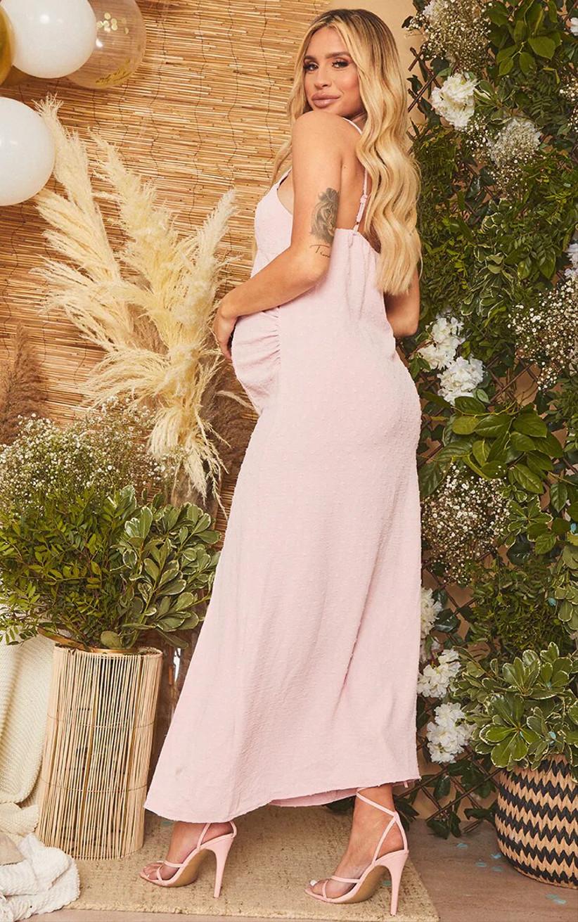 Pregnant model wearing a pink maxi wedding guest dress