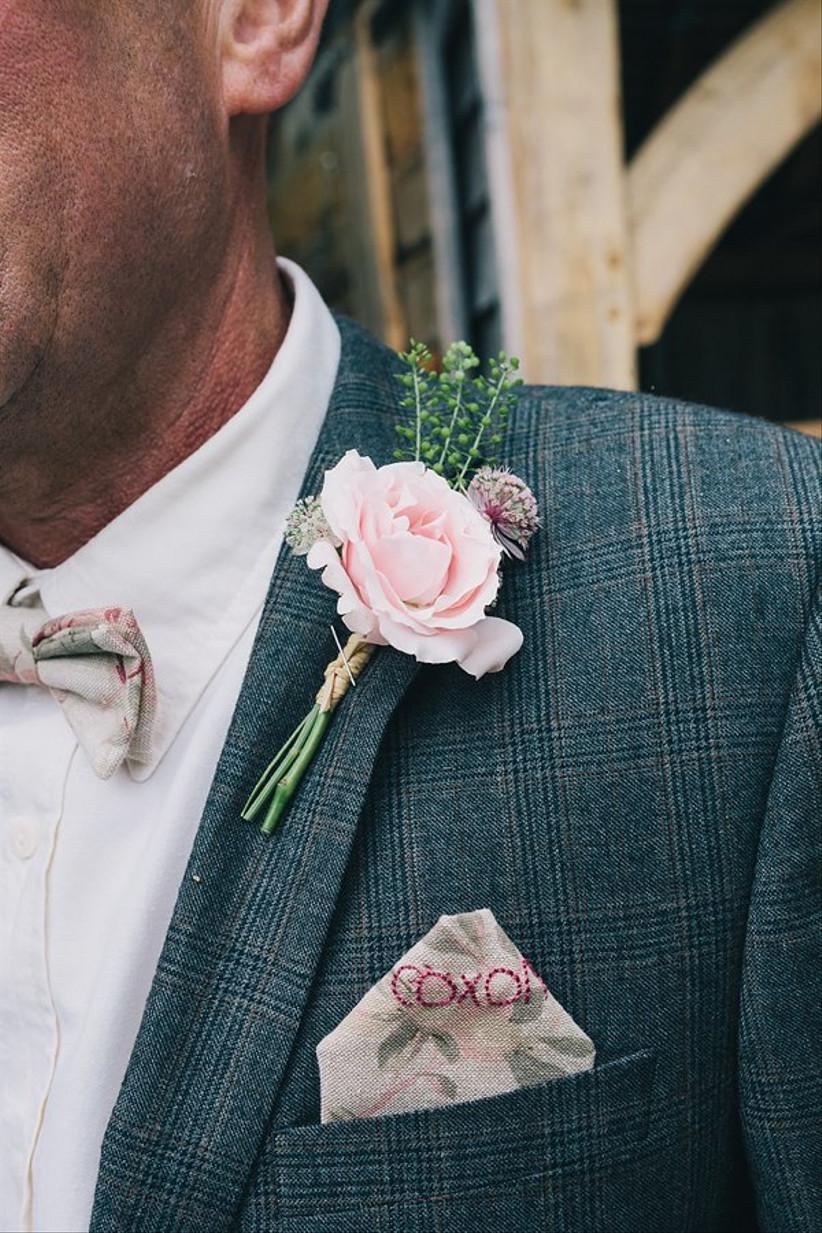 Groom wearing a vintage wedding buttonhole