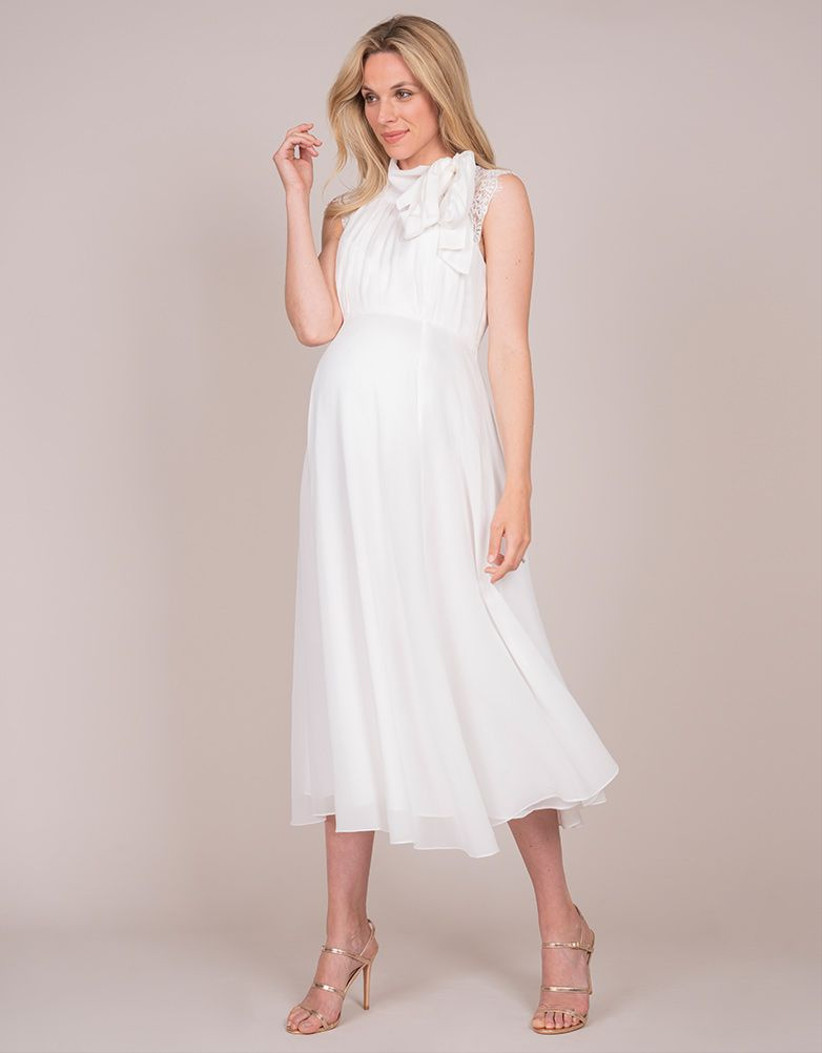 Model wearing a high neck maternity wedding dress