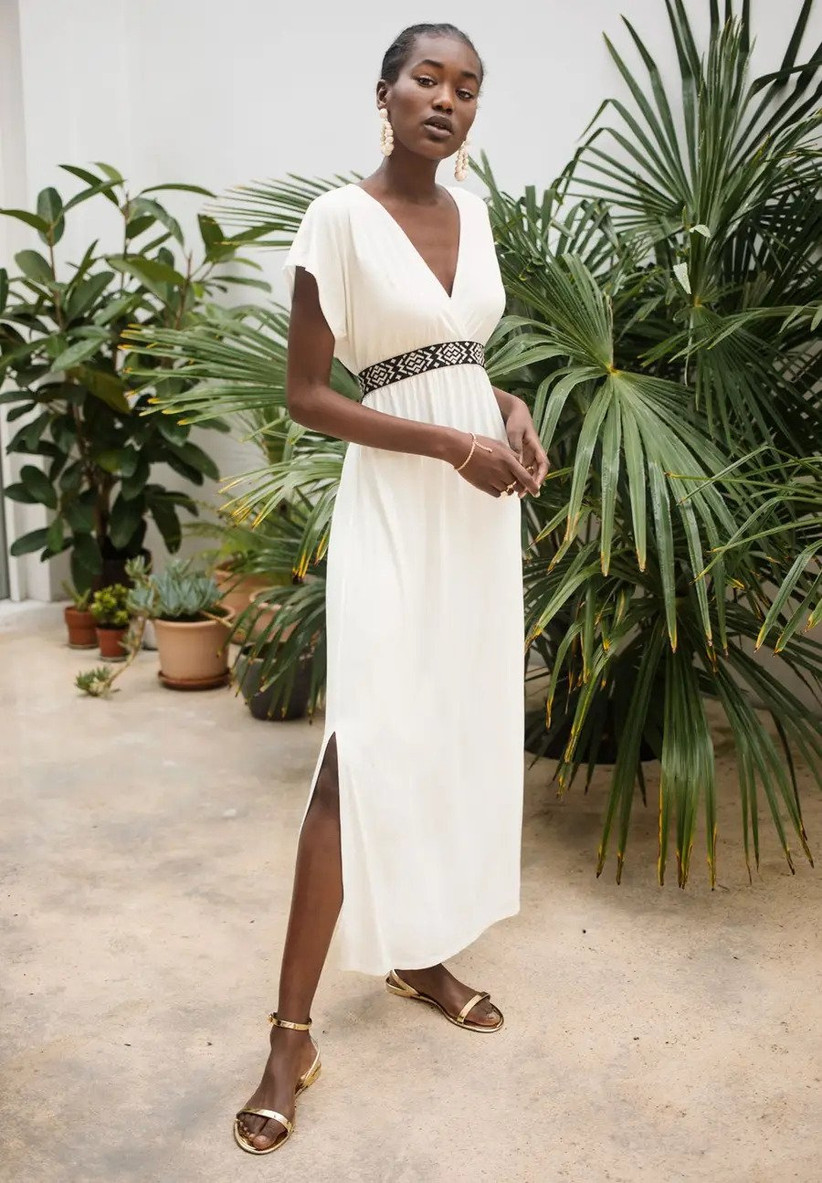 White dress with black patterned waistband