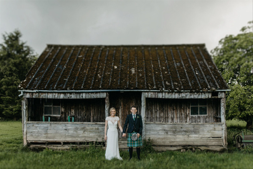 Bride and groom outside a rustic hut