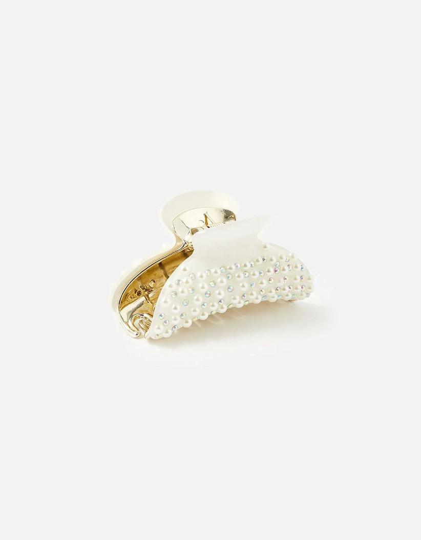 White bulldog clip covered in round diamantes