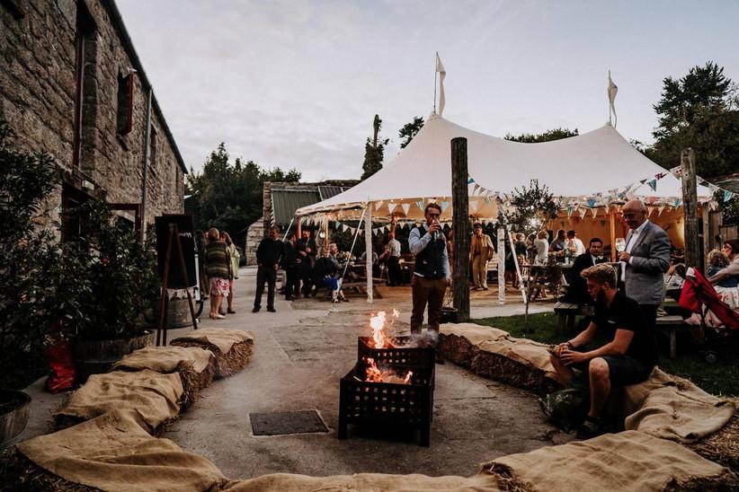 Wedding guests mingle outside a wedding venue