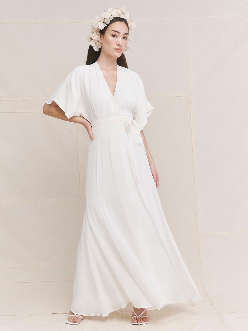 Model wearing a draping wedding dress