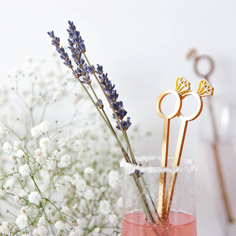 Gold diamond cocktail stirrers in a cocktail