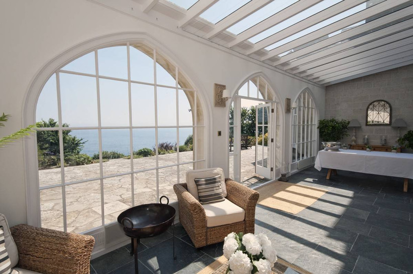 A conservatory overlooking the coast
