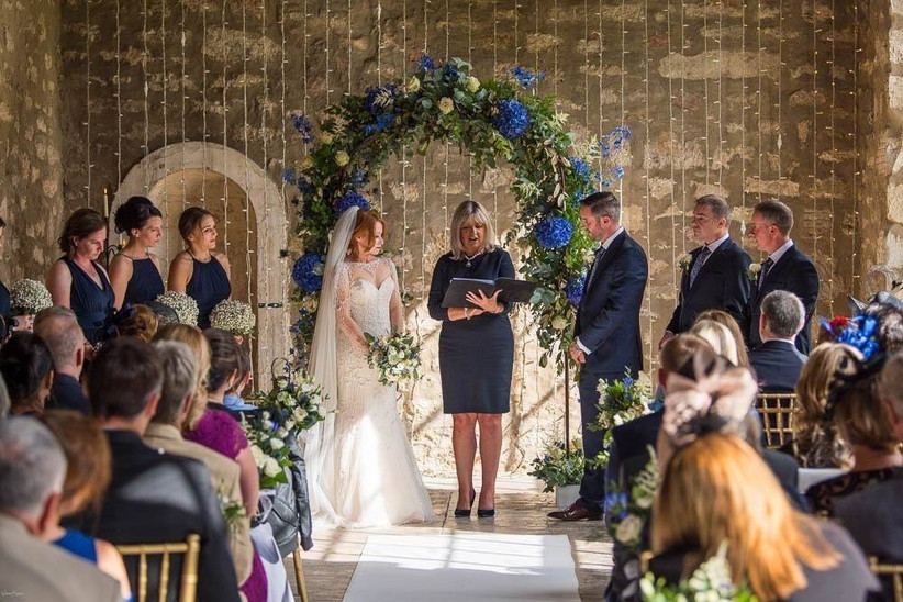 Wedding ceremony with a flower arch
