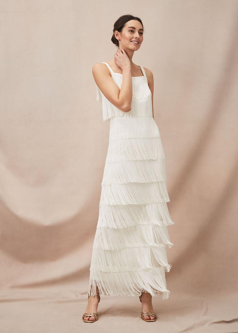 Model wearing a fringed wedding dress