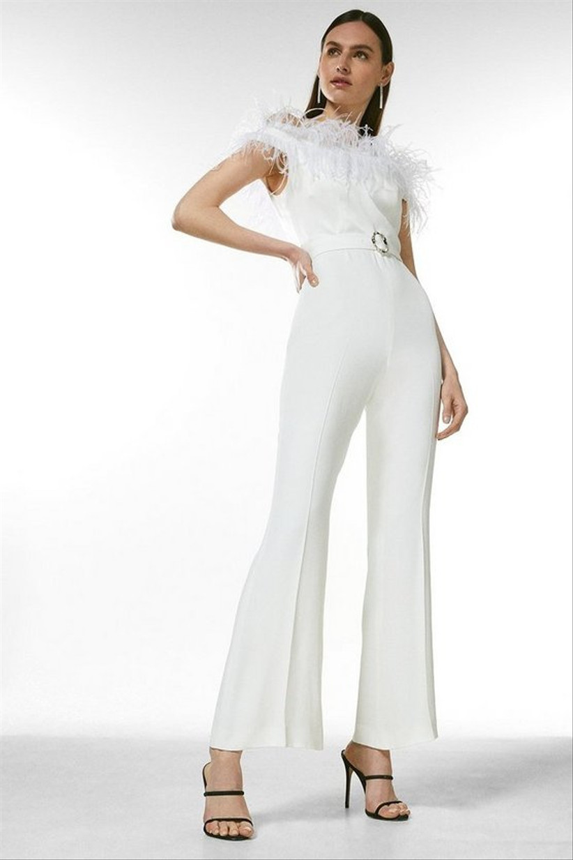 Model wearing a feather wedding jumpsuit