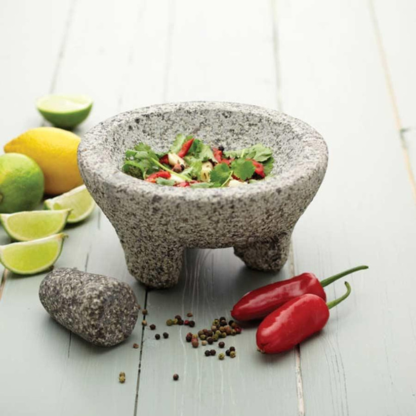 Granite mortar and pestle with limes and chillies