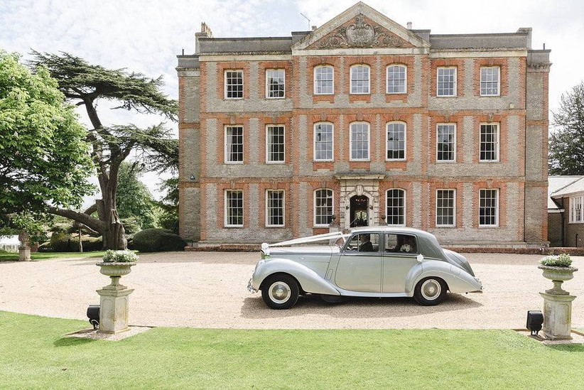 Classic car outside a country house wedding venue