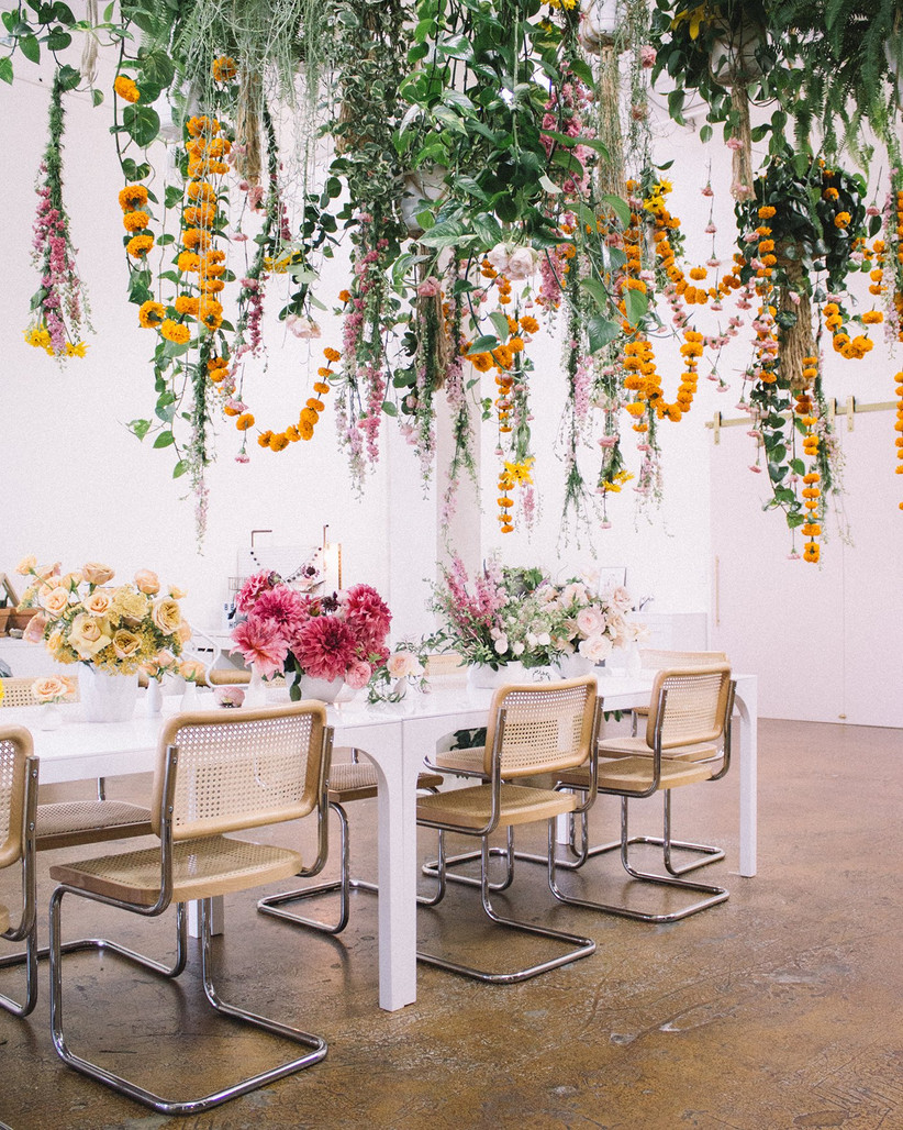 Strings of hanging wedding flower decorations