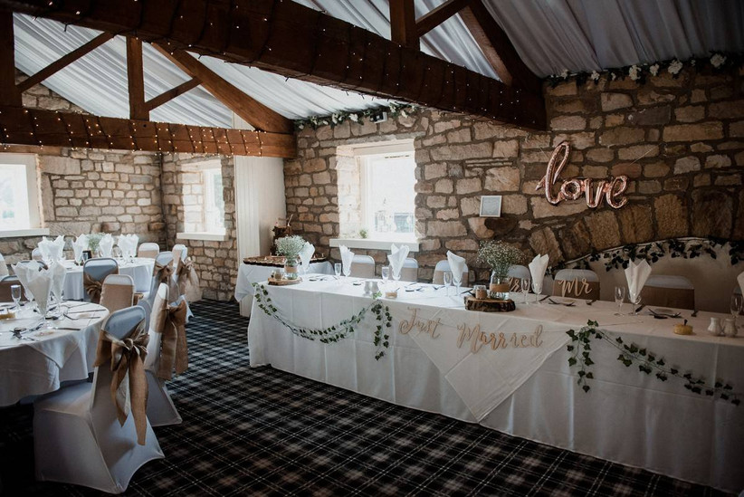 Top table in a wedding barn