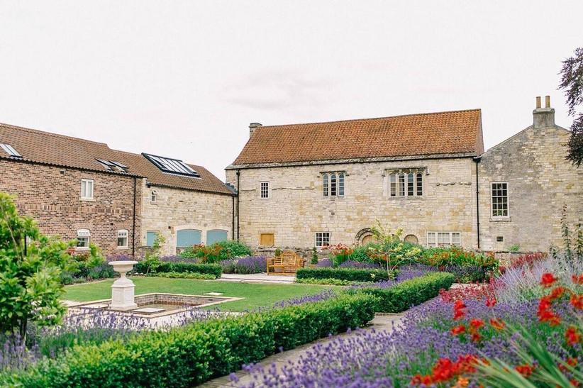 Barn wedding venue with floral borders