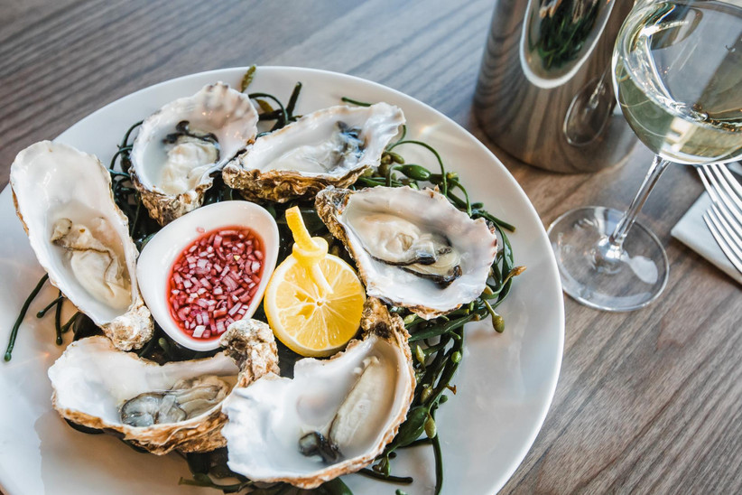 A plate of oysters with relish