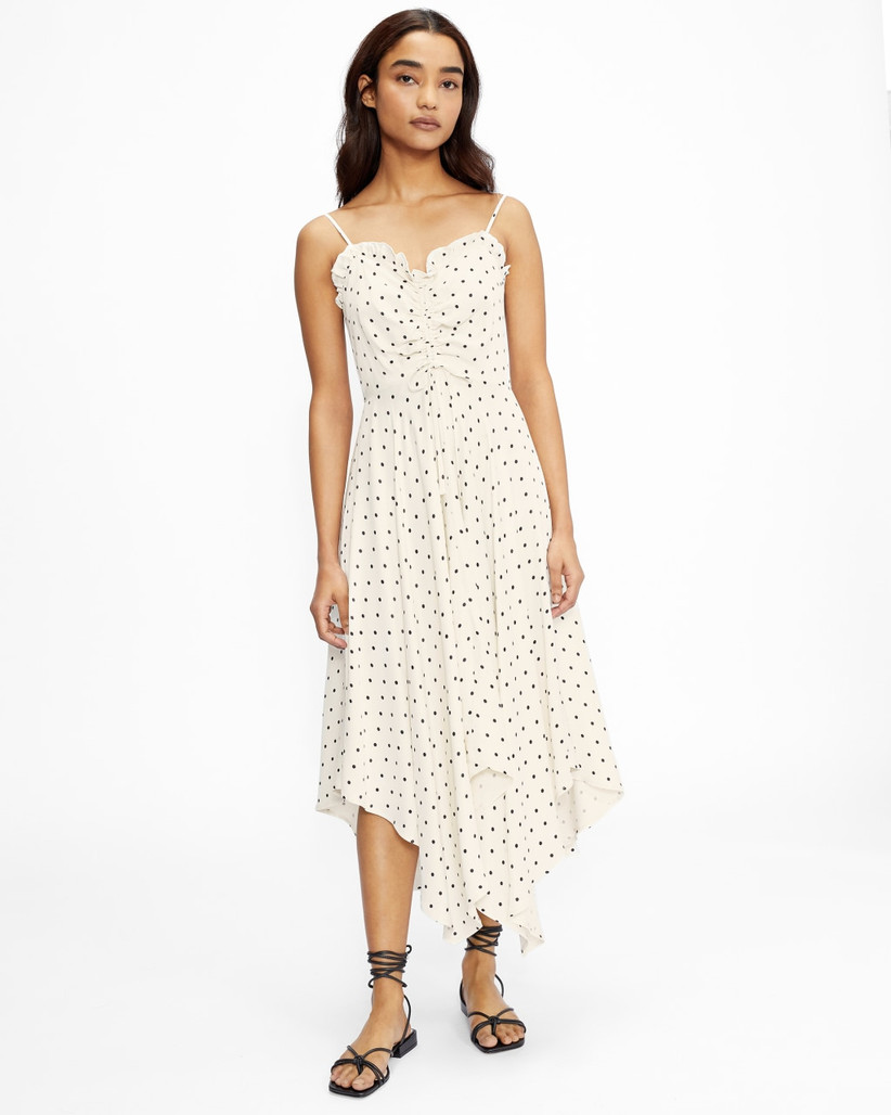 Model wearing a white polka dot bridesmaid dress