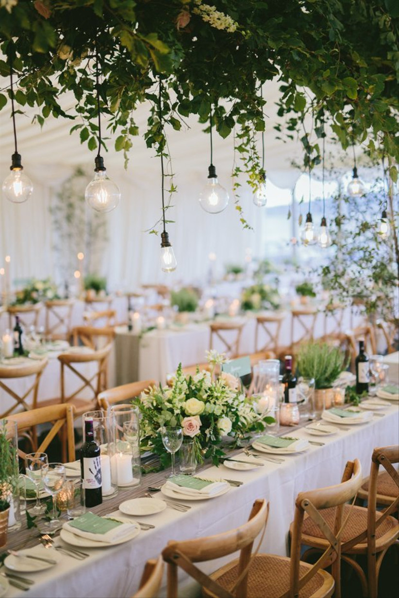 Hanging flowers above a wedding table with bulbs