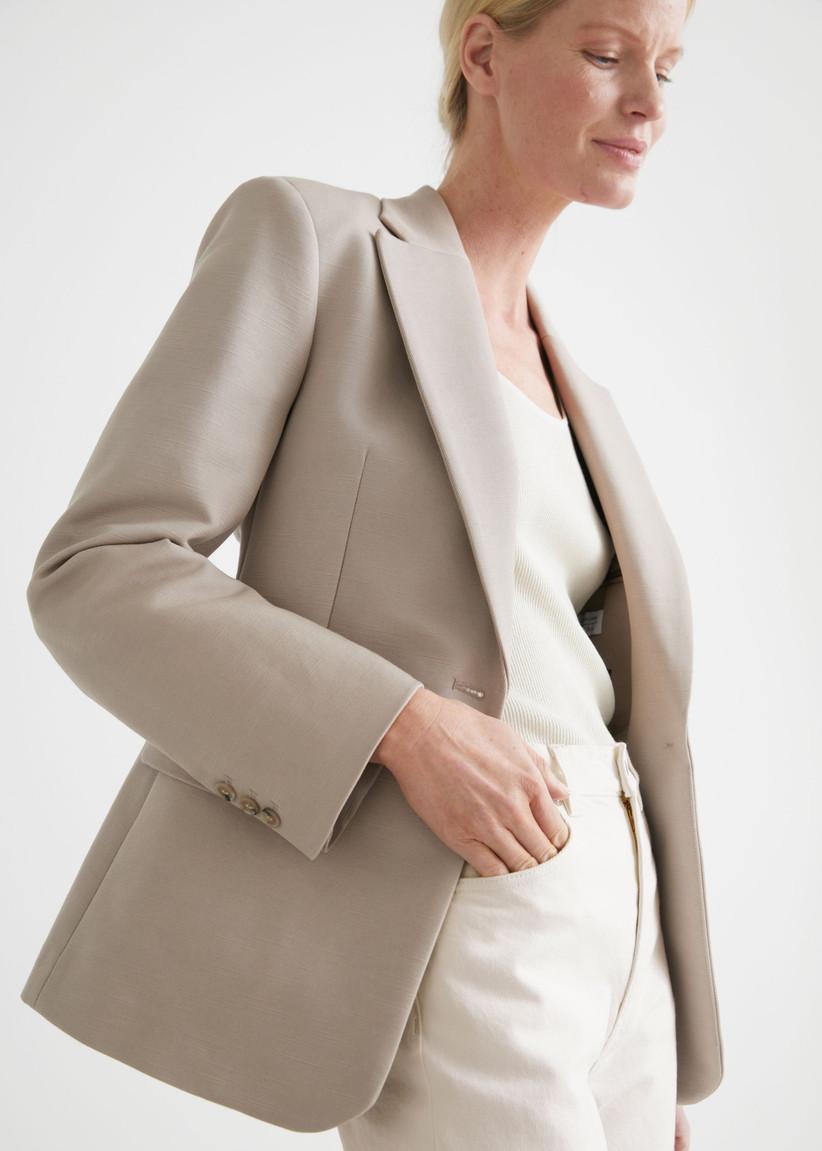 Model wearing a beige blazer