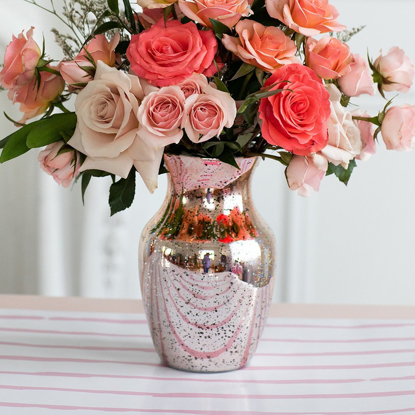 Rose gold glass vase with pink roses