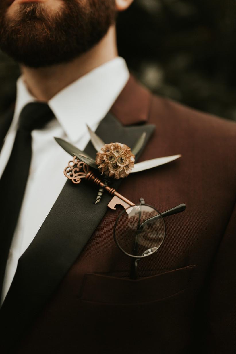 Groom wearing a Harry Potter wedding buttonhole