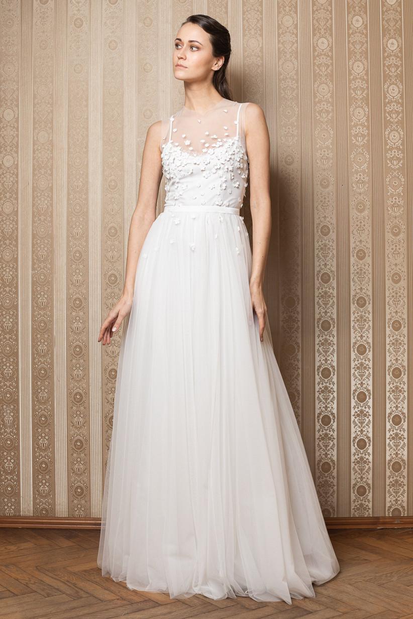 White wedding dress with white daisies on the bodice