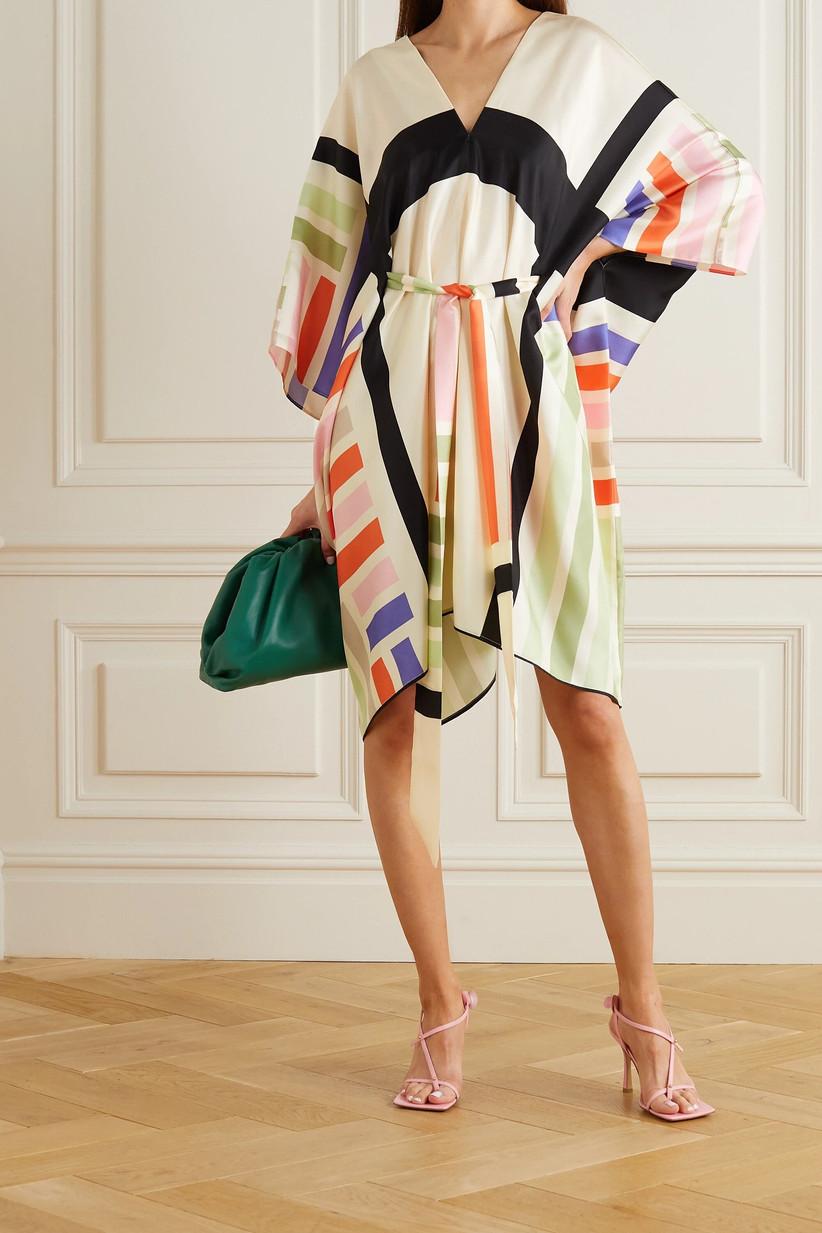 Model wearing a geometric pattern wedding guest dress