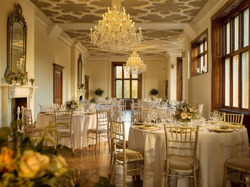 Dining area in a grand room at a wedding venue