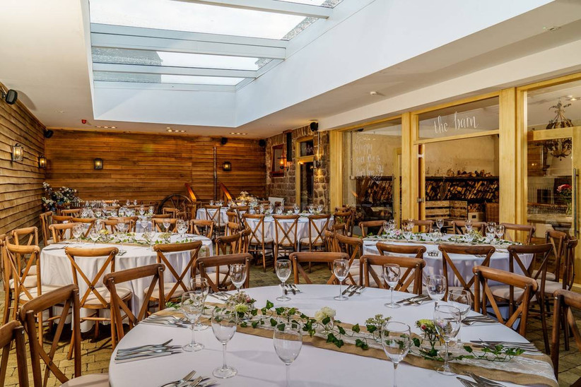 Wedding dining area with wood panelled walls