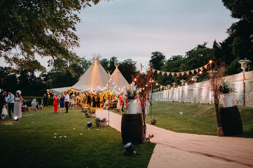 Wedding tipi decorated in bunting and fairy lights