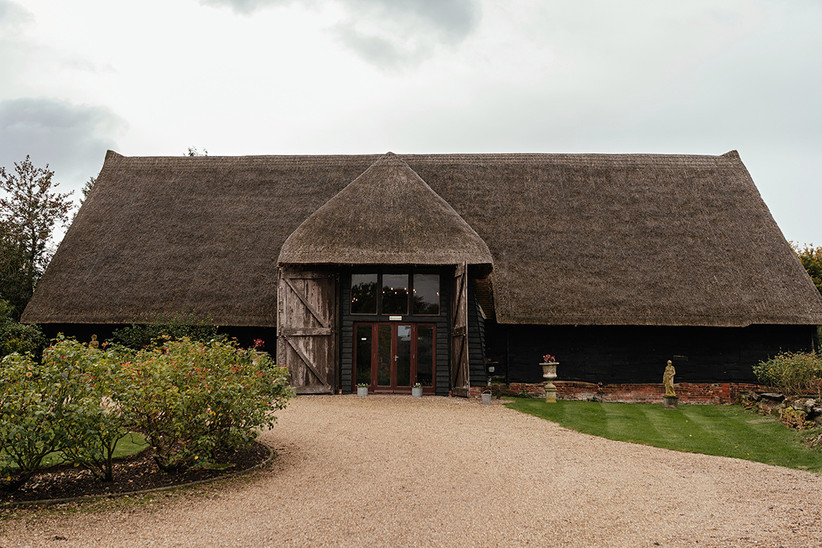 Exterior of Colvill Hall barn which has a brown thatched roof