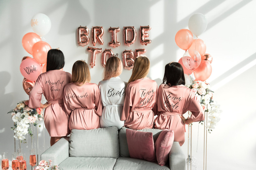 Bridesmaids and bride at a hen party with bride to be balloons