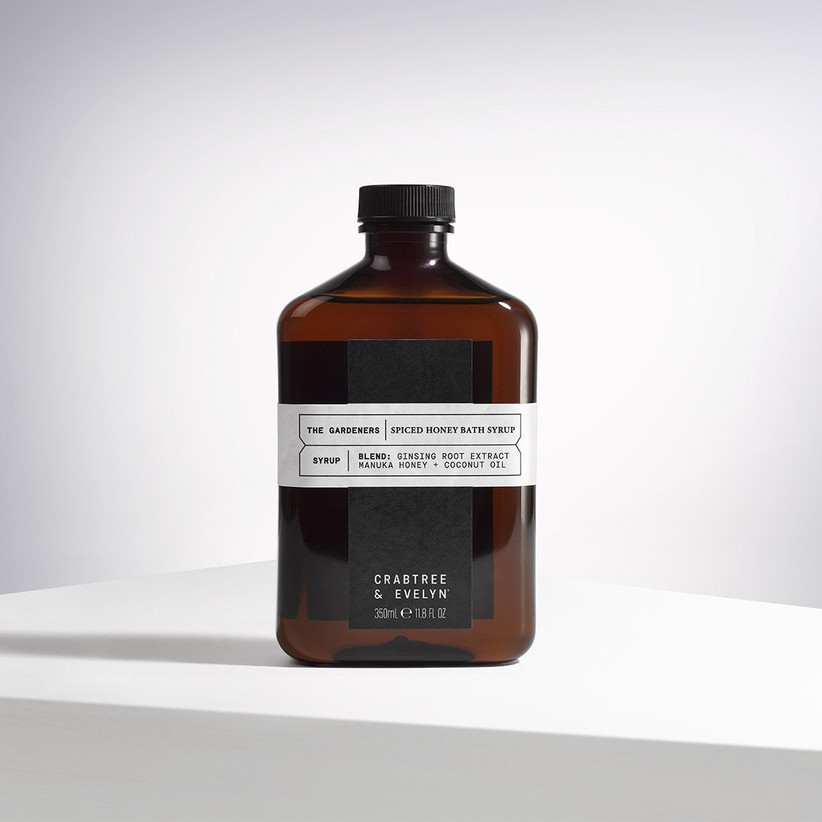 Crabtree and Evelyn Spiced Honey Bath Syrup in a dark brown apothecary style glass bottle