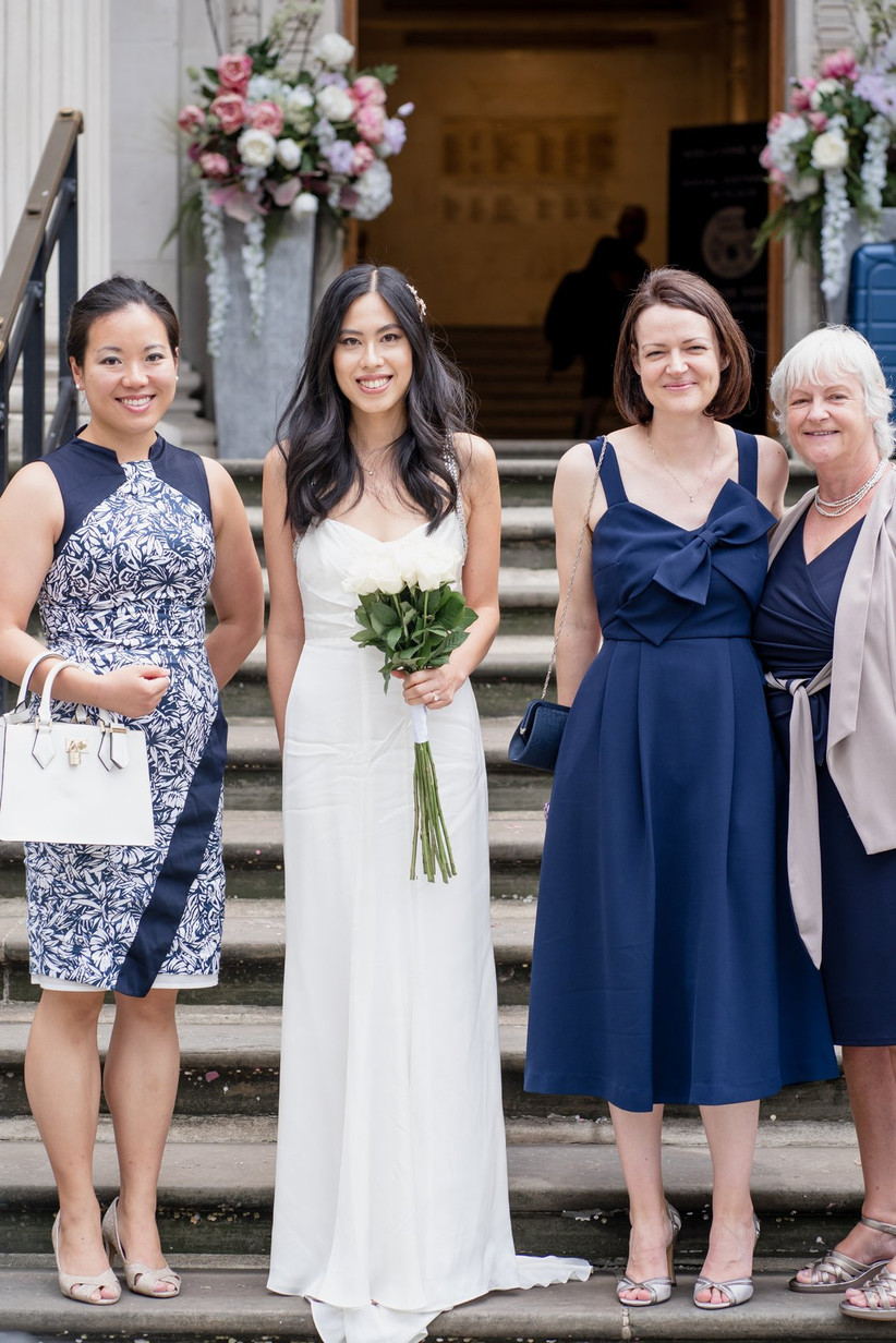 Bride standing with guests outside Old Marylebone Town Hall