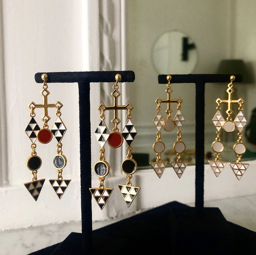 Two pairs of geometric monochrome and neutral earring on black earring posts