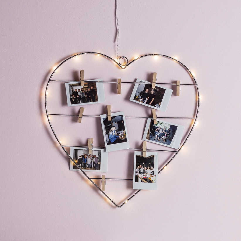 Light up wire heart with photos pegged on