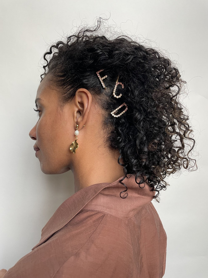 Side up curly hair with letter clips