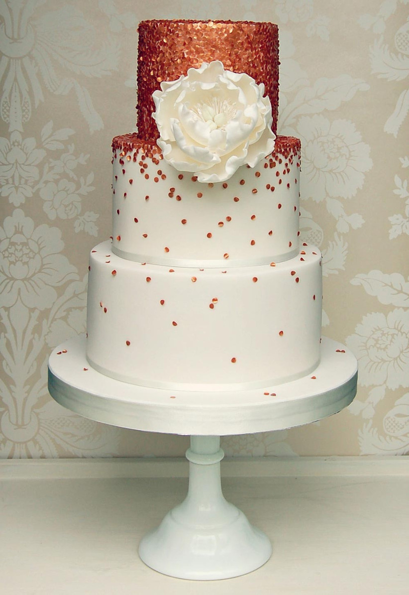 white-wedding-cake-with-rose-gold-detailing