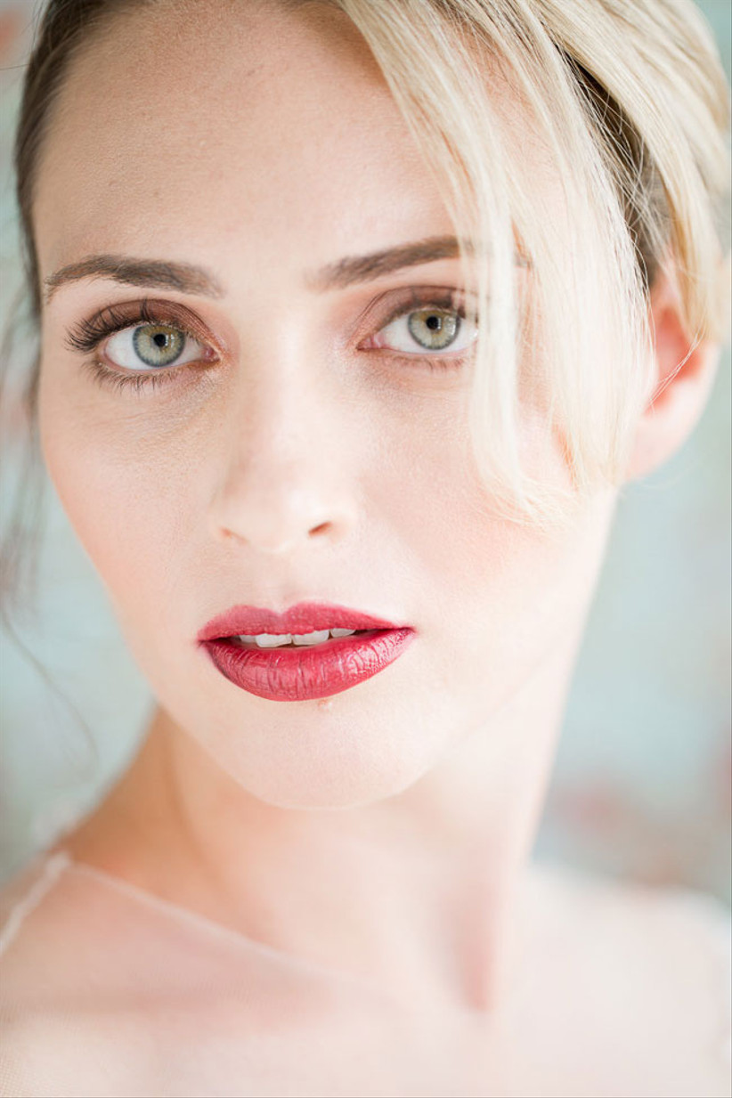 Bride with berry coloured lipstick