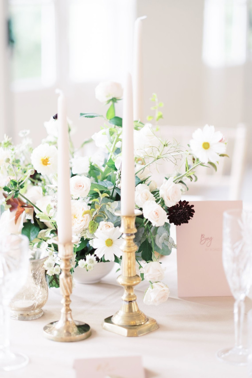 Flowers and candles on a reception table
