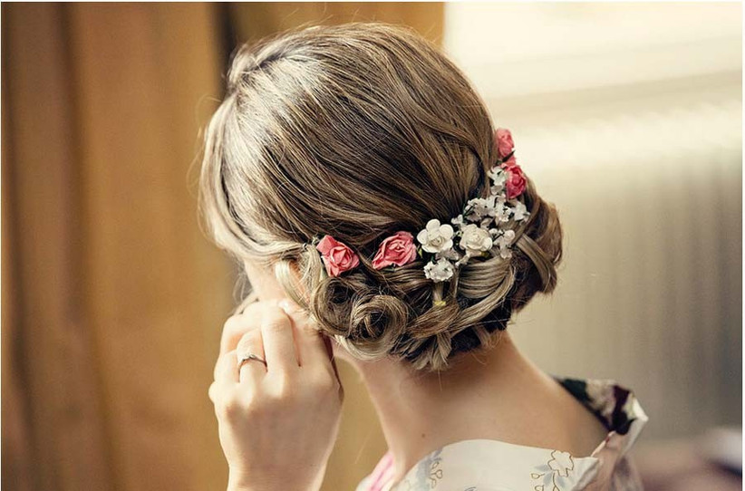 for-wedding-hair-flowers-with-a-60s-and-70s-twist-try-weaving-smaller-flowers-into-a-pretty-updo-like-this-look-from-lipstick-and-curls-2