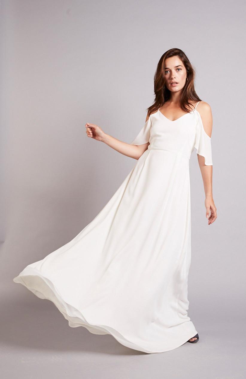 Model wearing a white Grecian bridesmaid dress