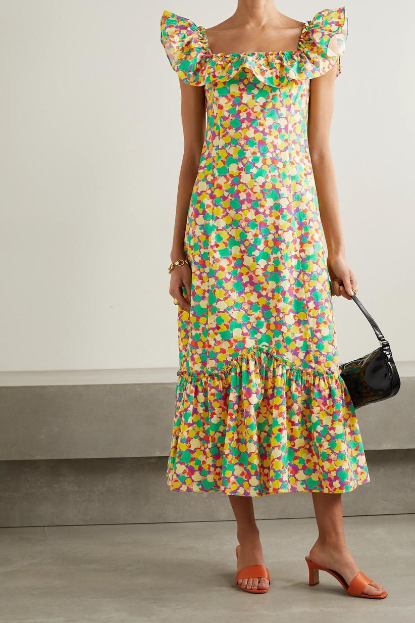 Girl wearing a ruffled bright printed midi dress with a drop hem