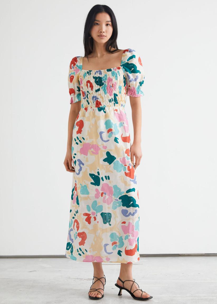 Girl wearing a puff sleeve bold print midi dress