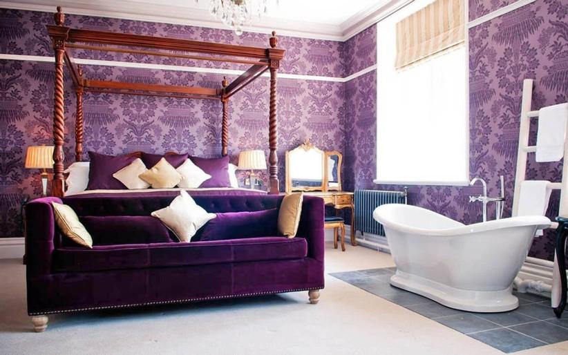 Purple elegant bedroom with a bath