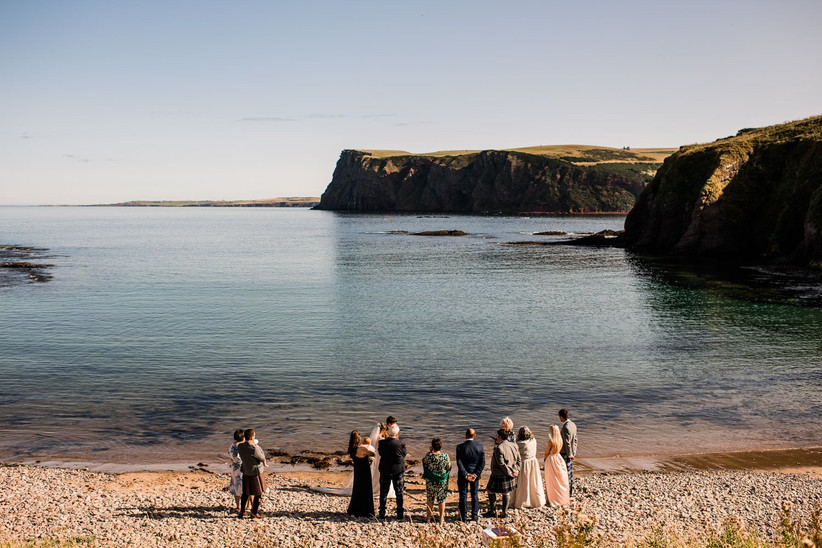 The wedding party on the beach from a distance