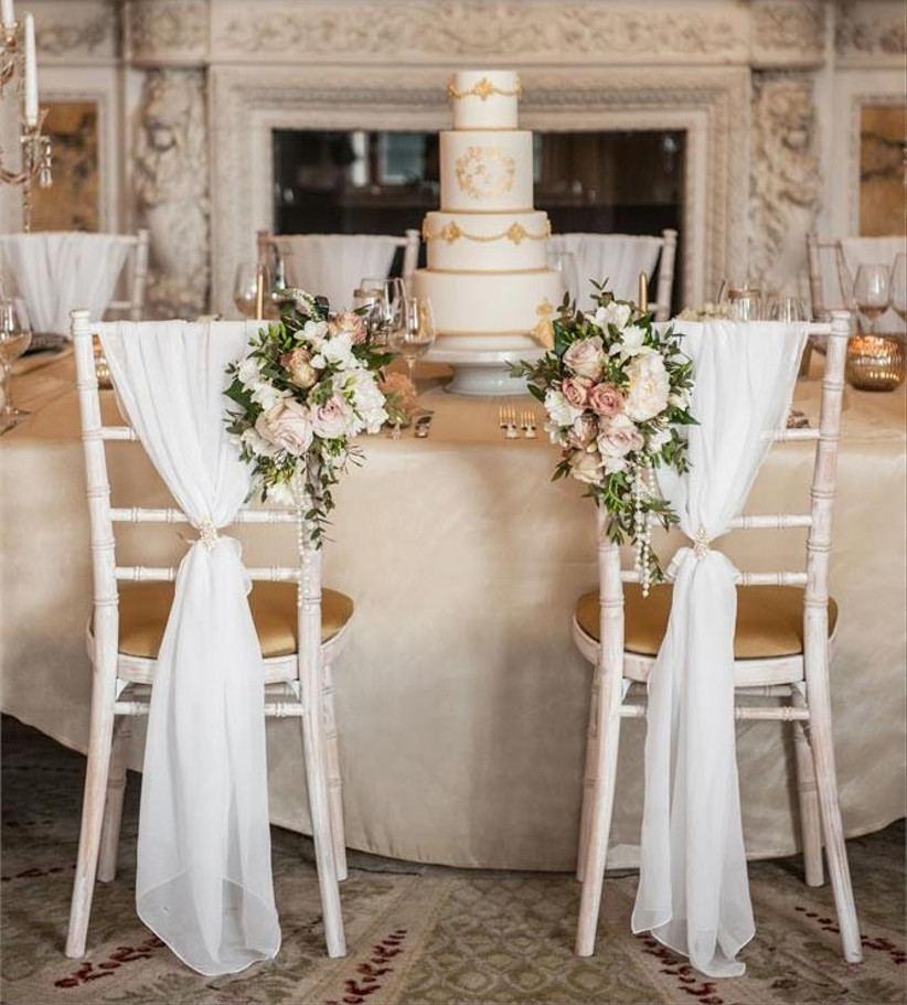 draped-chair-sashes-with-flowers