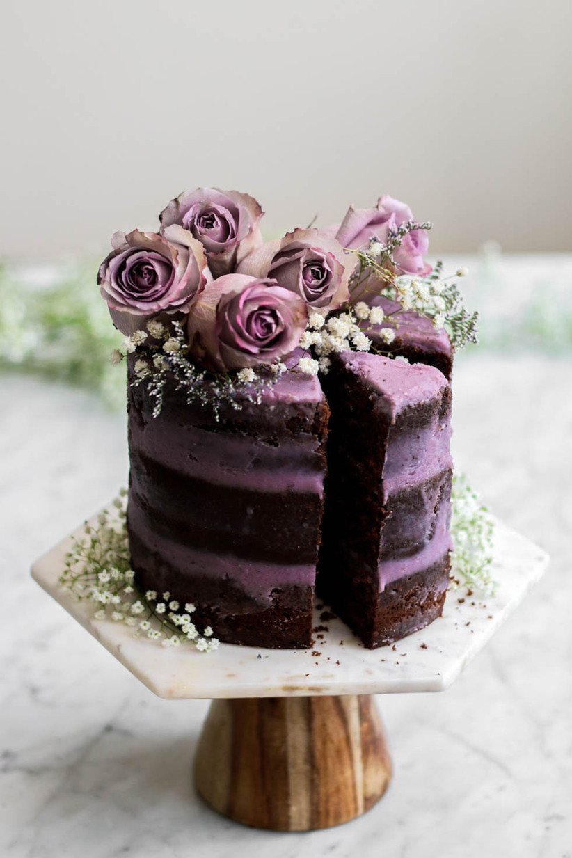 Single tier rustic wedding cake with lilac icing and roses