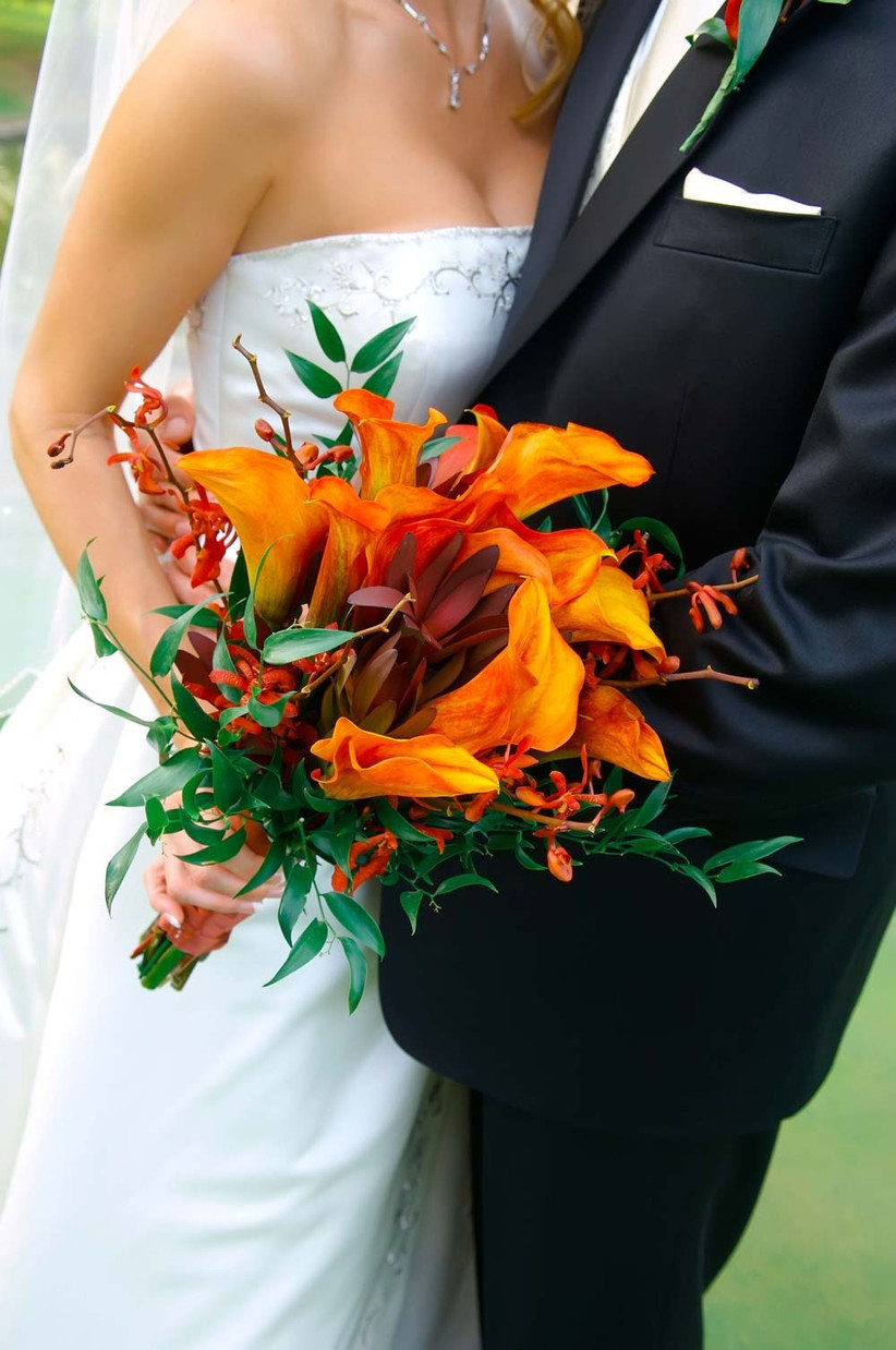 for-your-autumn-bouquet-choose-seasonal-wedding-flowers-that-have-interesting-shapes-such-as-these-burnt-orange-calla-lilies