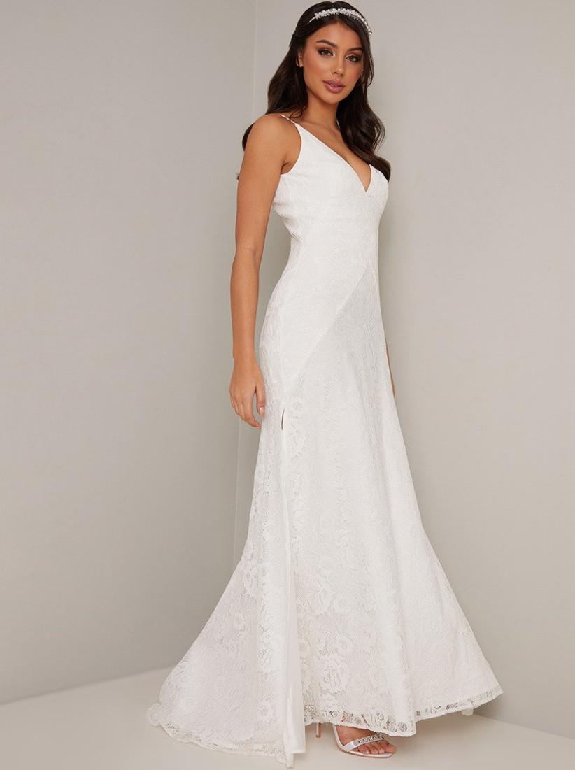 Girl wearing a V-neck white lace wedding dress